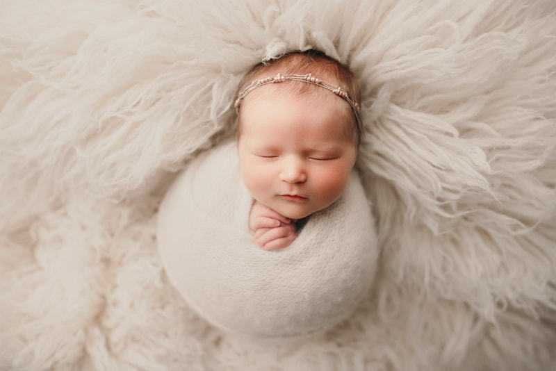 Wellsville NY Family & Newborn Photographer, baby swaddled in fluffy white fabric