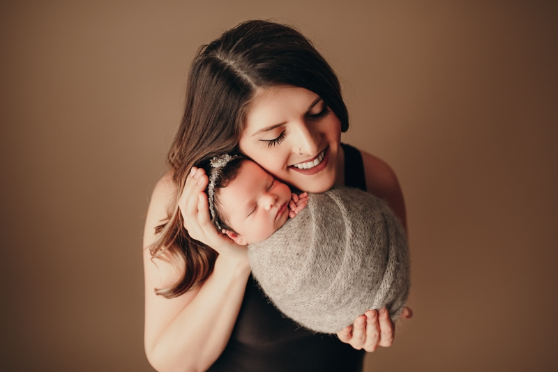 Wellsville NY Family & Newborn Photographer, swaddled baby sleep next to mother's cheek