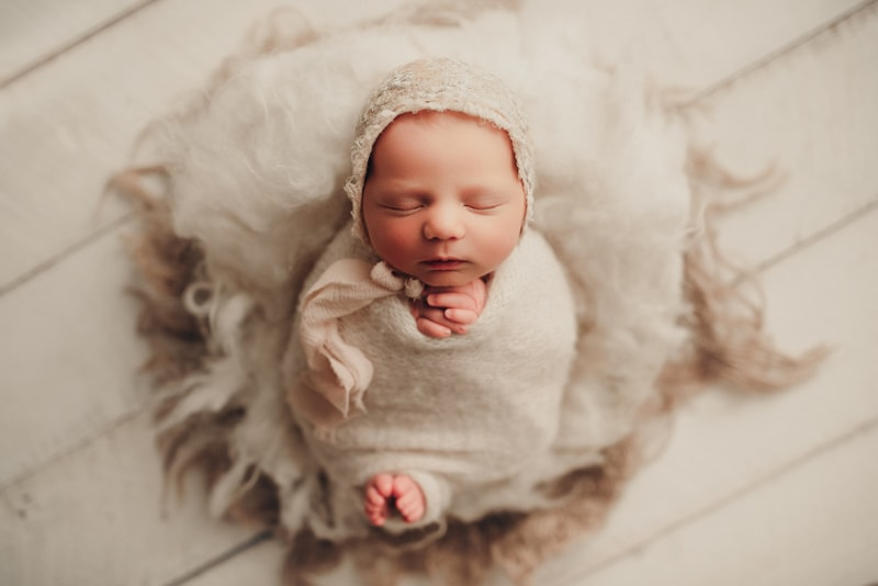 Wellsville NY Family & Newborn Photographer, swaddled baby asleep with toes sticking out