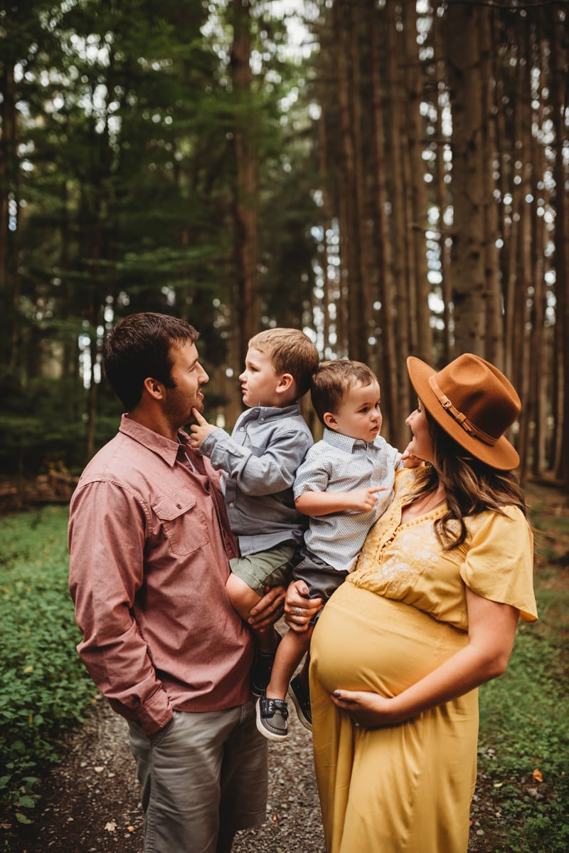 Wellsville NY Family & Newborn Photographer, family of 4 standing in the woods