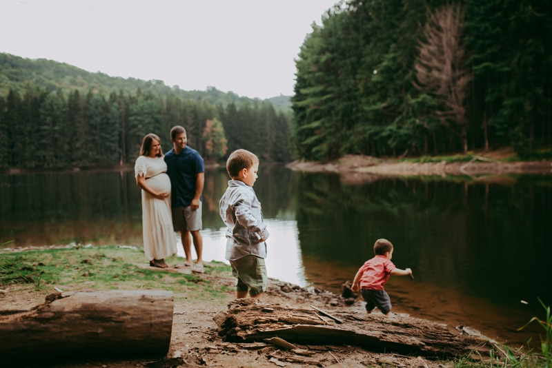 Wellsville NY Family & Newborn Photographer, little boys skipping rocks in the river