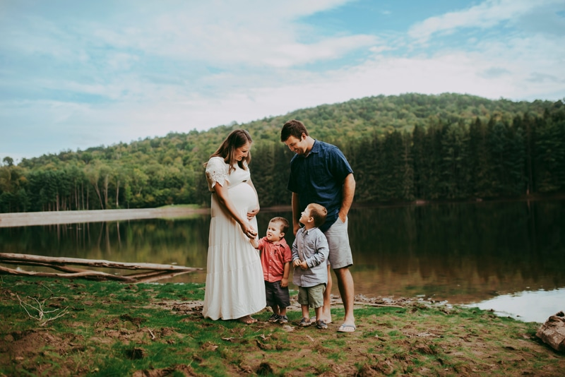 Wellsville NY Family & Newborn Photographer, family of 4 standing next to the lake
