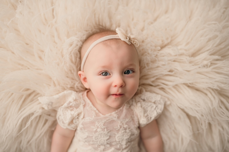 Wellsville NY Family and Newborn Photographer, little girl with cream colored bow in her hair
