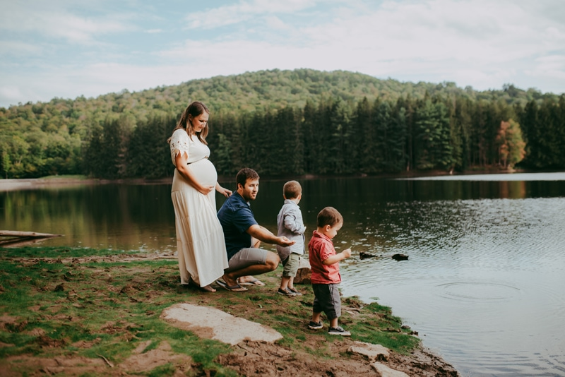Wellsville NY Family & Newborn Photographer, family standing next to the end of the lake