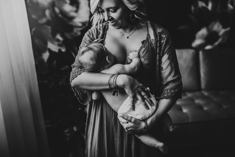 Wellsville NY Family and Newborn Photographer, black and white image of mother breastfeeding child