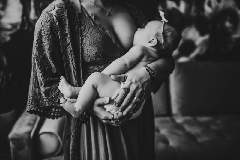 Wellsville NY Family and Newborn Photographer, black and white of mother breastfeeding her childr