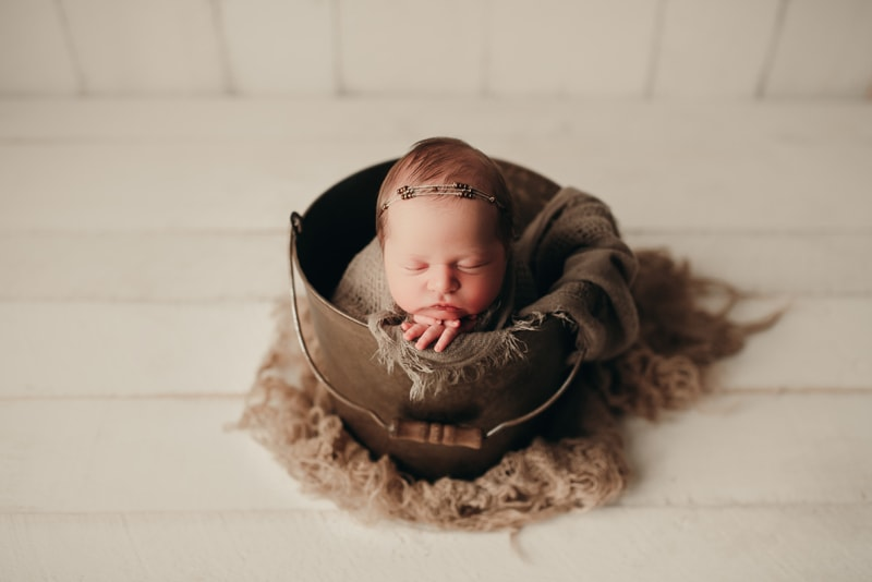 Wellsville NY Family and Newborn Photographer, baby asleep in metal bucket