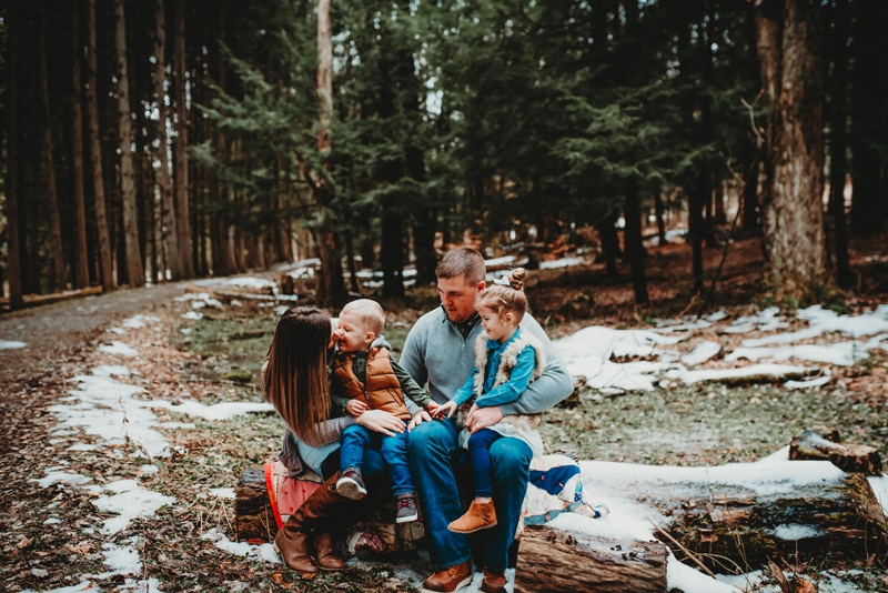 Wellsville NY Family and Newborn Photographer, family of four sitting on a log